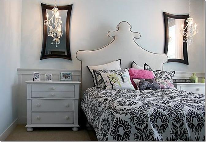 изогнутое белое с черным кантом тканевое изголовье кровати