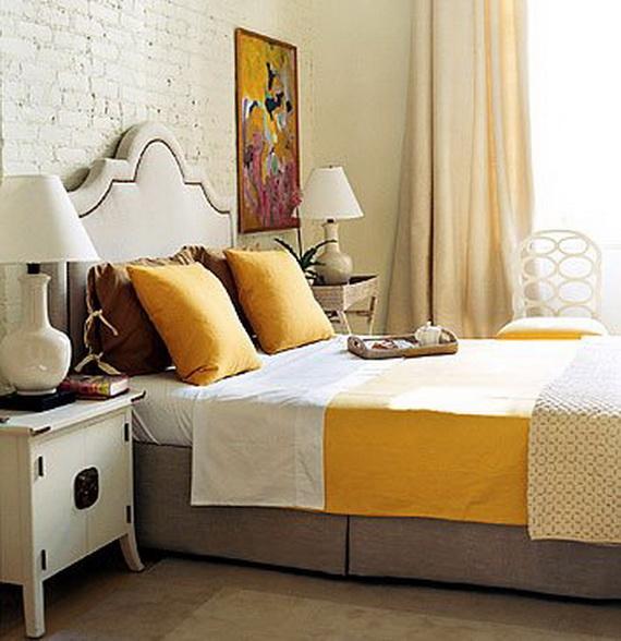 кирпичная стена в спальне с кожаным изголовьем